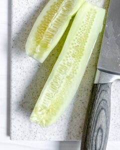 process for Soba Salad with Sunomono-Style Cucumbers with sliced cucumber on cutting board
