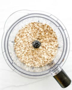 process of oats in blender against white surface