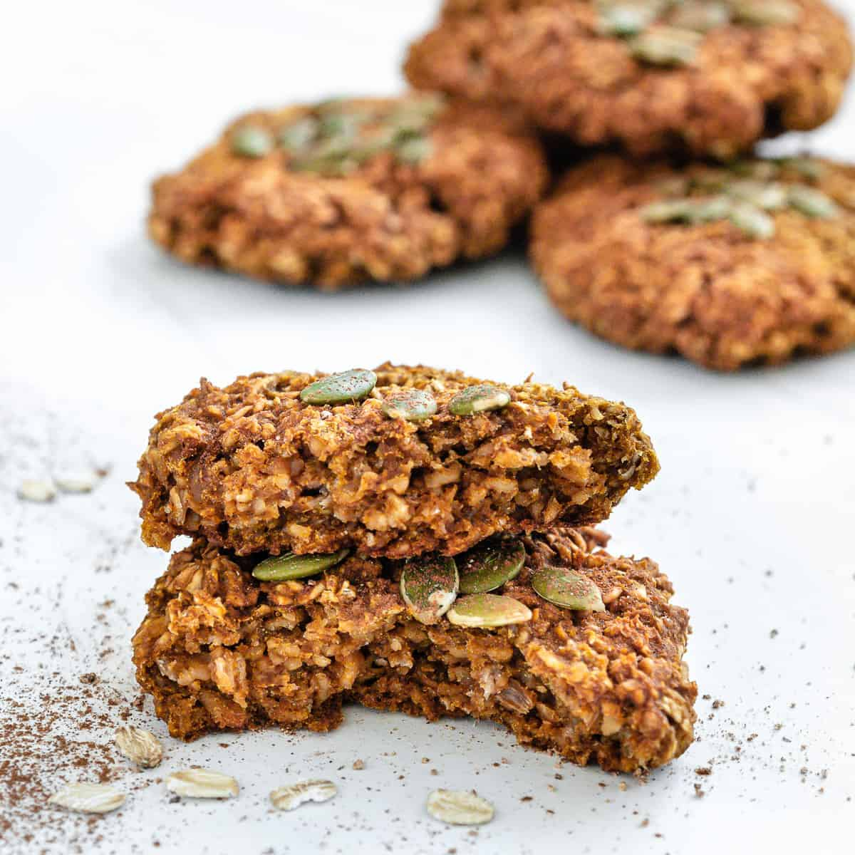 completed close up of Vegan Pumpkin Oatmeal Cookies against a white surface