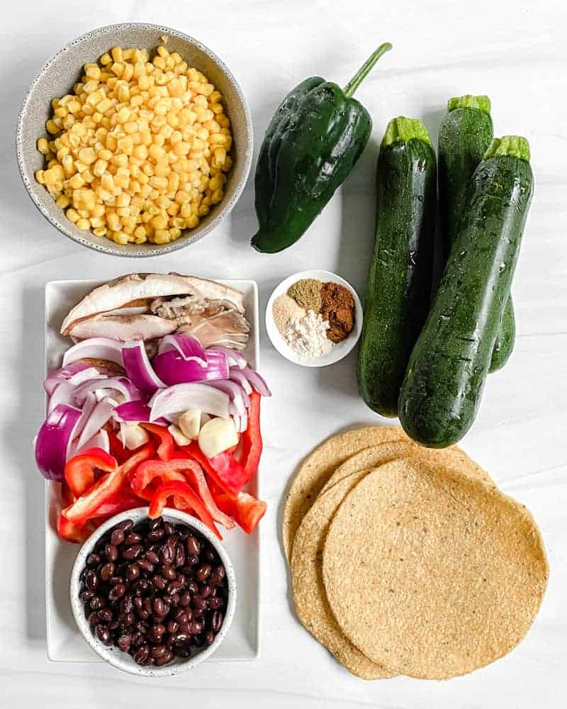 Vegan Roasted Veggie Tacos ingredients against a white background
