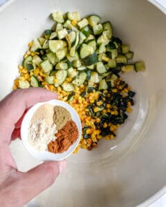various ingredients in a white bowl against a white background