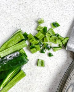 chopped celery against a white background