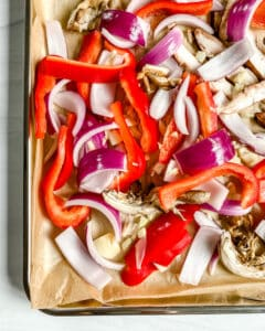 chopped peppers and mushrooms against a white background