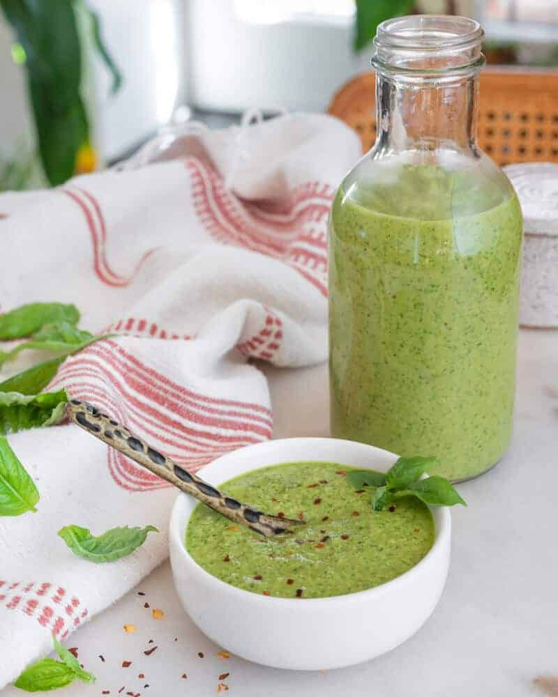 basil salad dressing ingredients in a white background