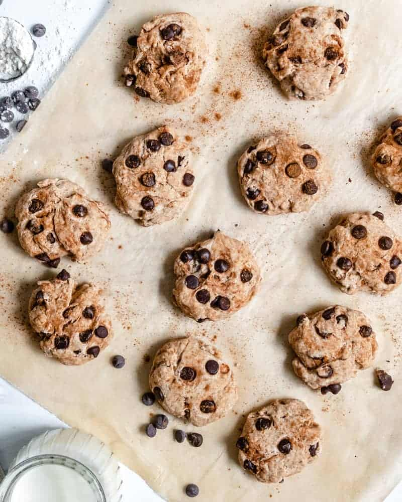 finished cinnamon chocolate chip cookies on parchment paper with cinnamon in the background
