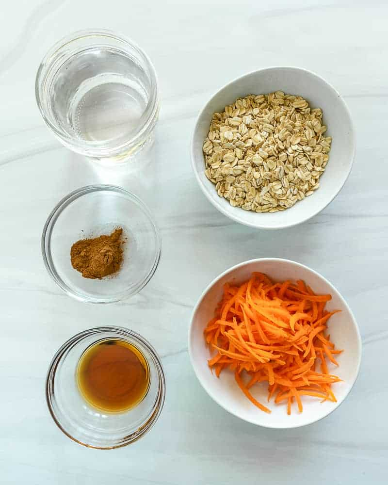 carrot cake oatmeal ingredients on a white background surface