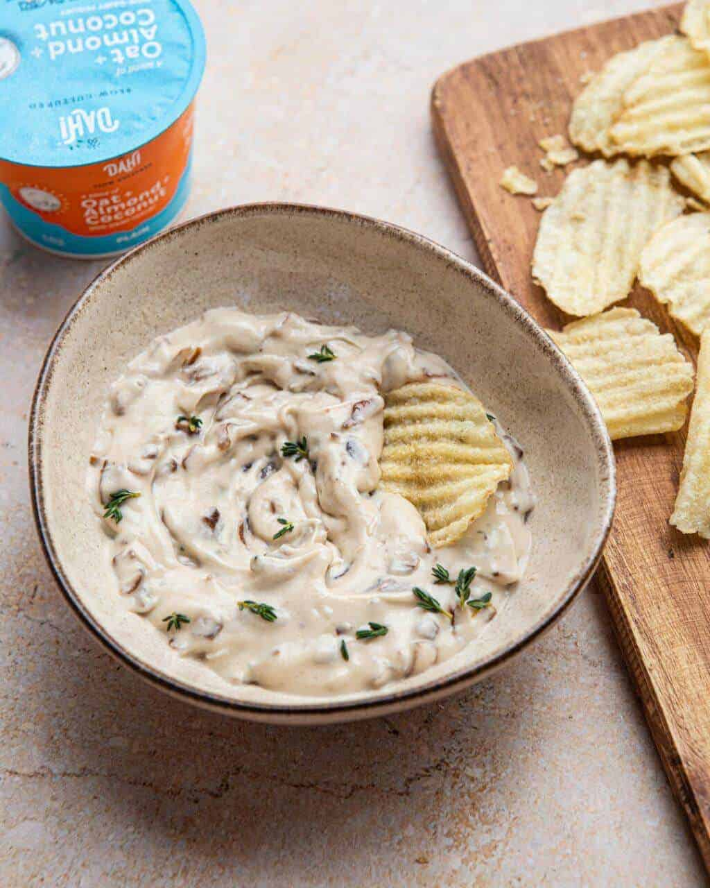 Vegan French Onion Dip in a Bowl with Some Potato Chips for Dipping