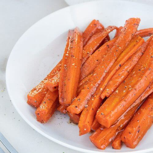 Glazed Carrots on a white plate in a white background