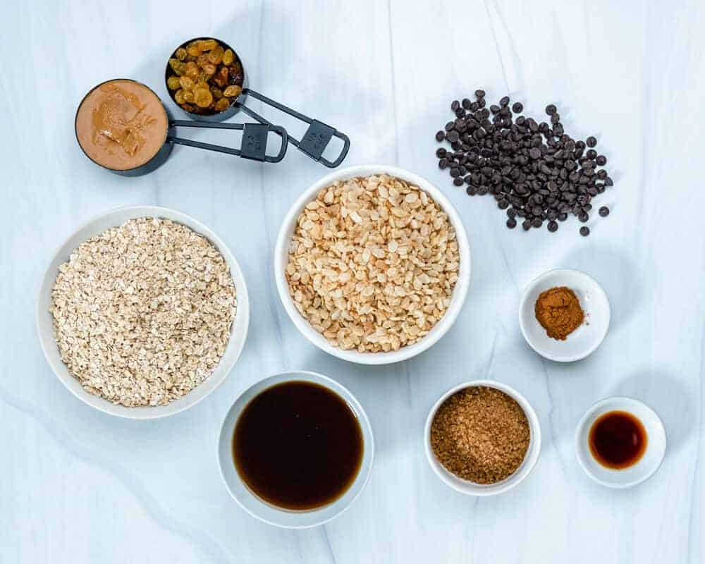 Ingredients of Chewy Gluten-Free Peanut Butter Granola Bars Laid out on a Marble White Surface