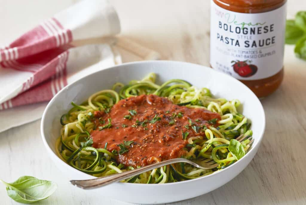 vegan bolognese sauce with product in a white bowl