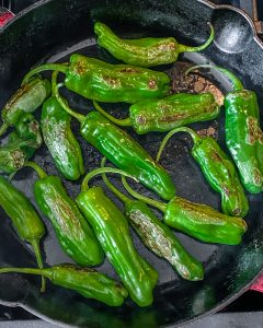 shishito peppers cooked in pan