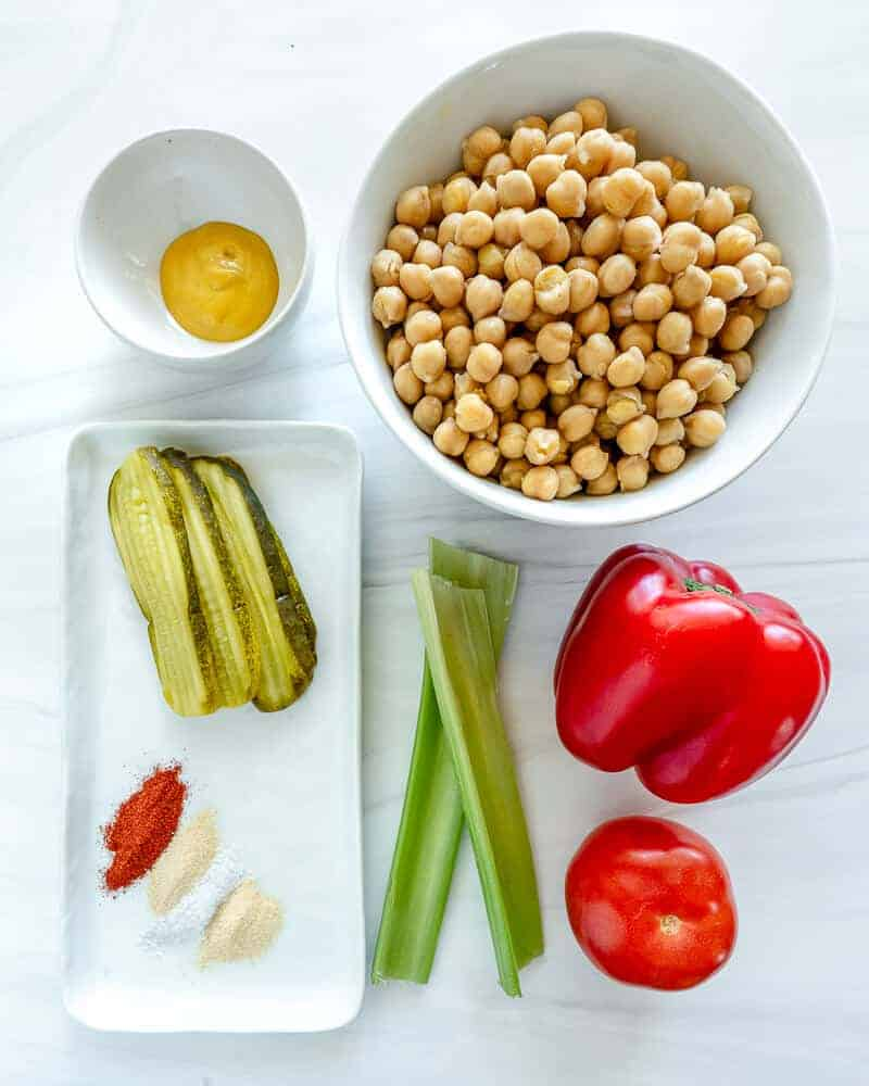 ingredients for Oil-Free Chickpea Salad in a white background