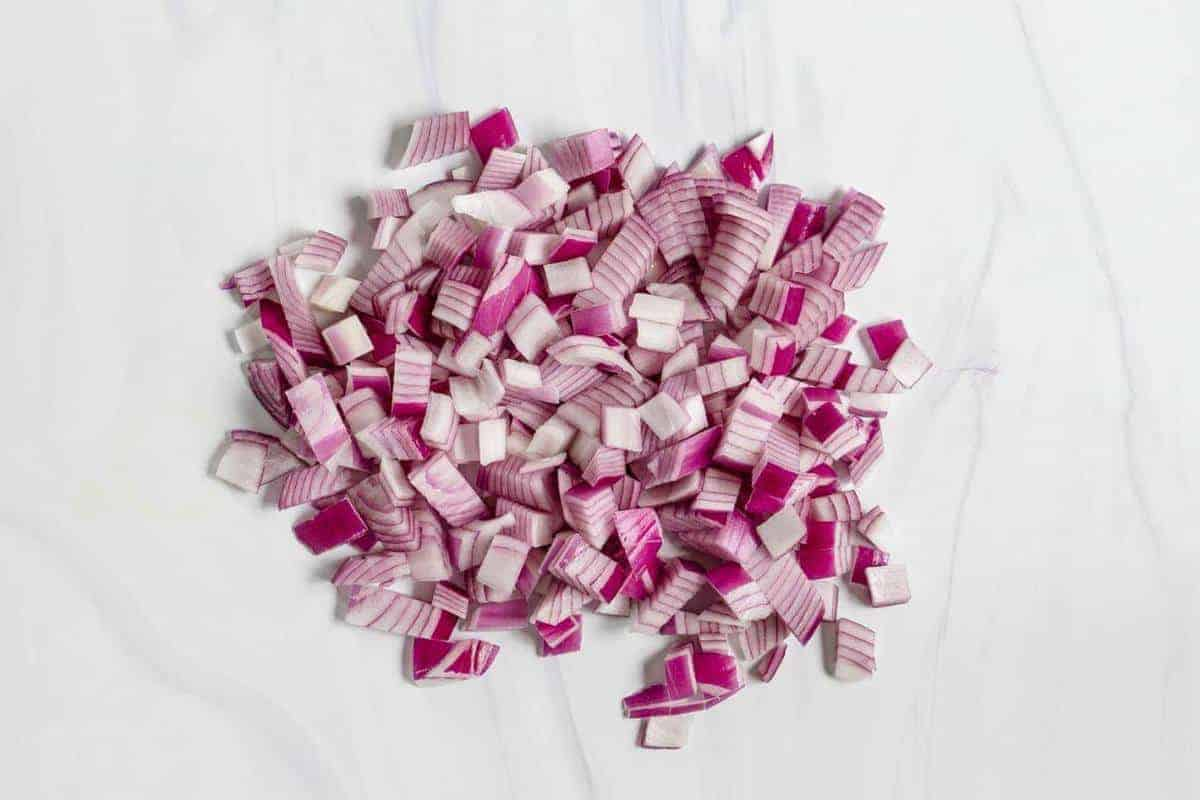 Diced Red Onions on a Marble Surface