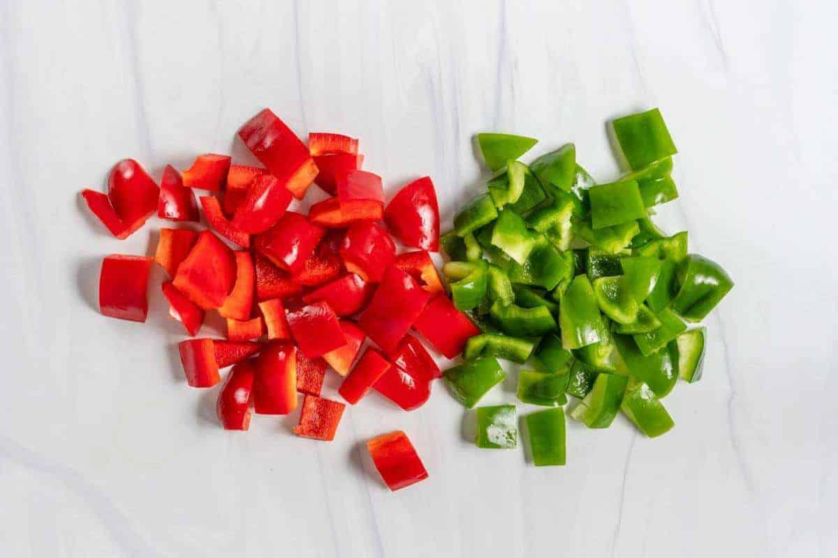 Chopped Red and Green Bell Pepper on a Marble Surface