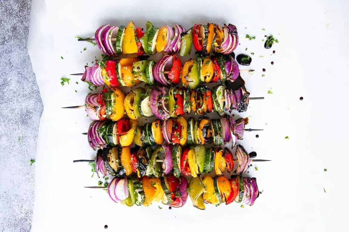 6 veggie kebabs with mixed vegetables on skewers with a white background