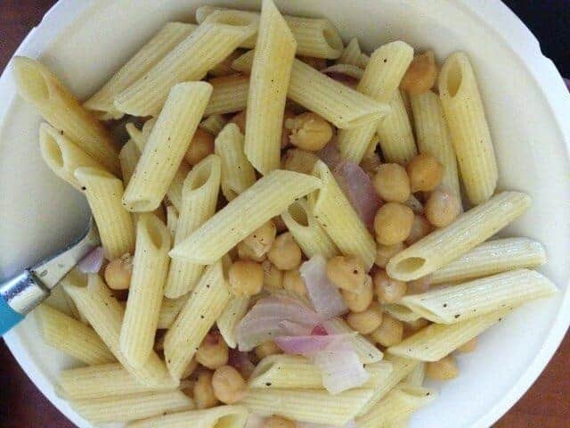 Chickpea penne pasta salad in a white bowl.