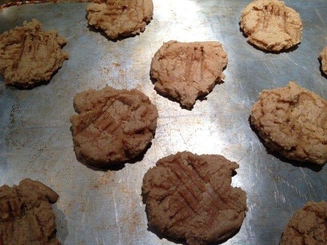 Baked vegan peanut butter cookies on a baking sheet.