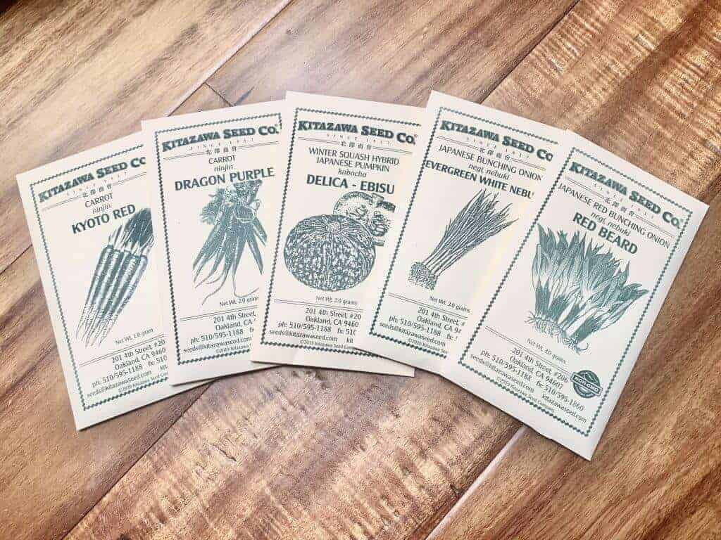 Kitazawa Seed Co packets spread out on a wood table.