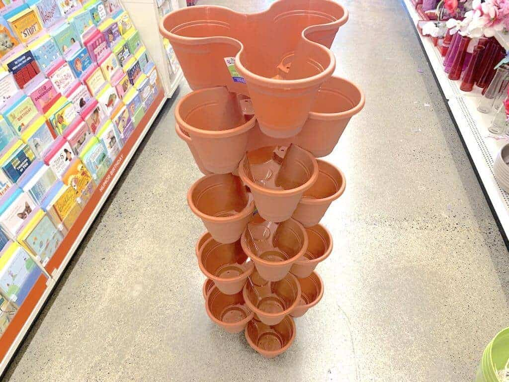 Empty flower pots stacked up high.