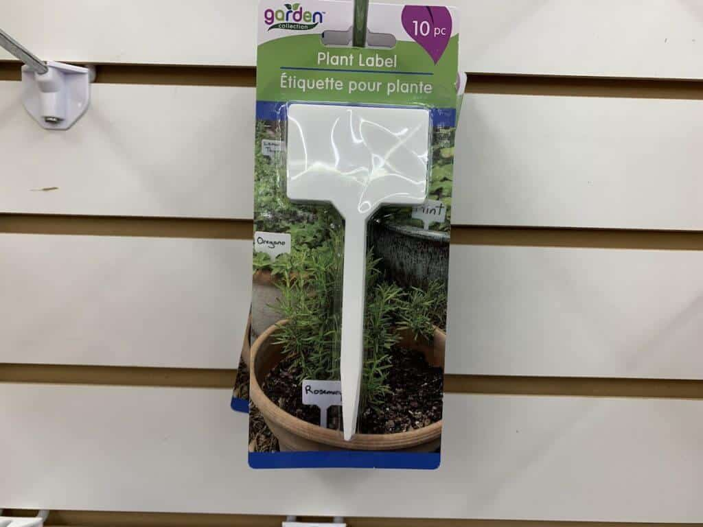 Packet of blank plant labels hanging on a shelf.