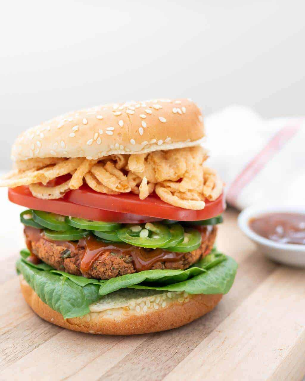 spicy red bean burger on wooden surface with white background