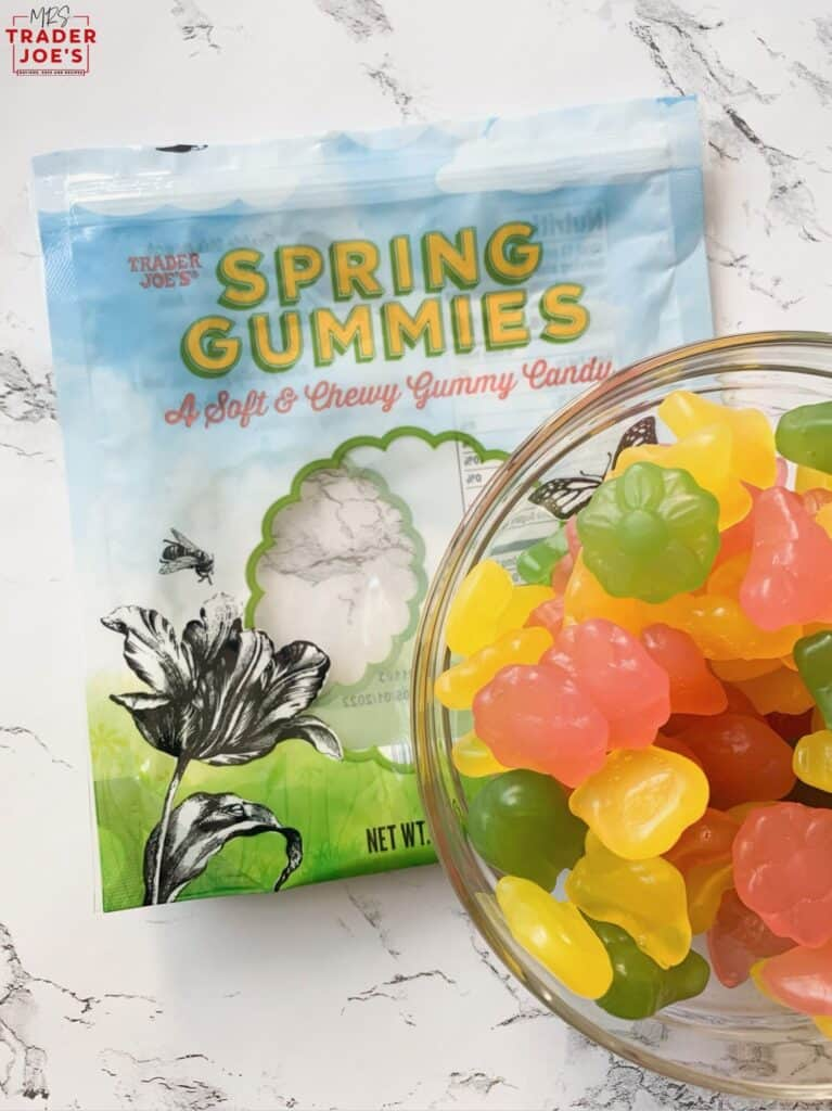 spring gummies packaging with gummies in glass bowl against a marble background