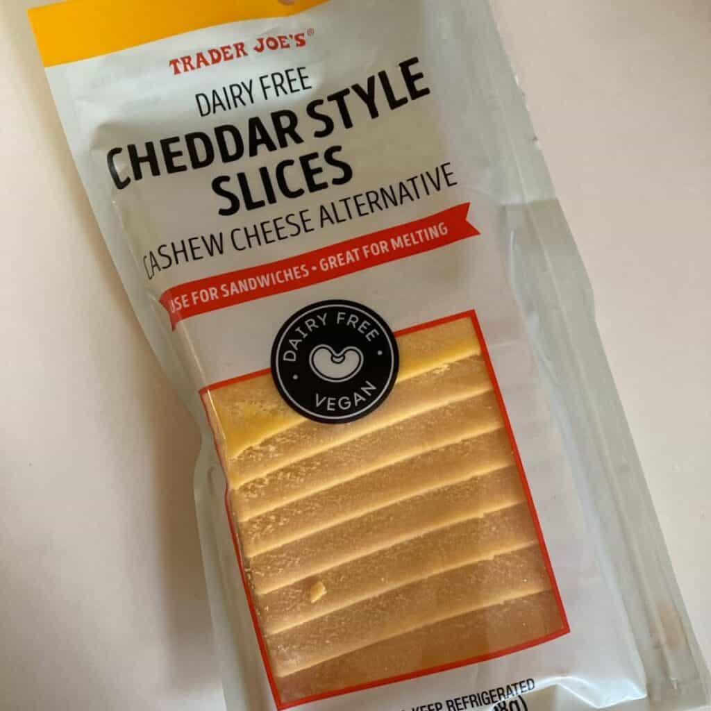 TJ cheddar slices in packaging against light background