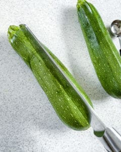 process of slicing zucchinis lengthwise