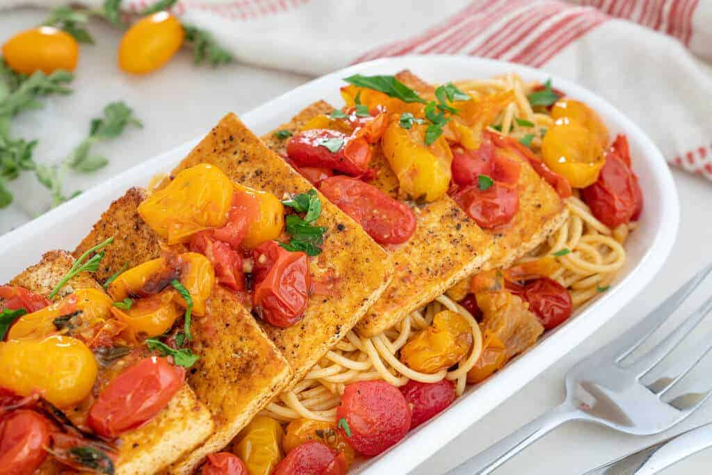 Italian Inspired Tofu Fillets Served on a Long Platter with Spaghetti