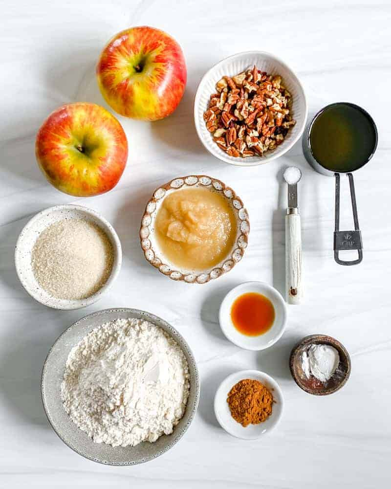 Apple Cinnamon Bread Ingredients laid out against white marble surface
