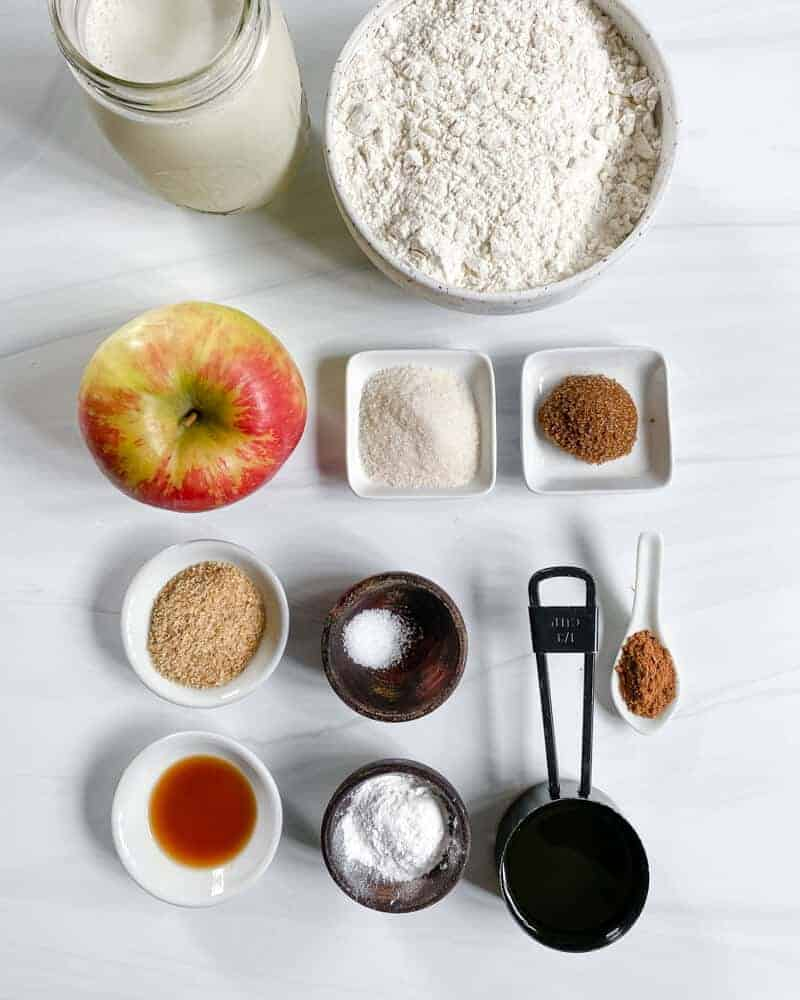 Apple Cinnamon Waffles Ingredients spread out on a white marble surface
