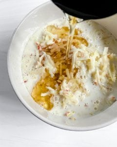 preparation of adding oil in a bowl of wet ingredients