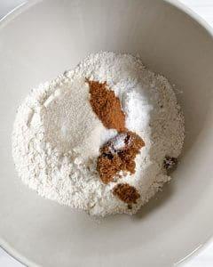 Dry ingredients of Apple Cinnamon Waffles in white bowl