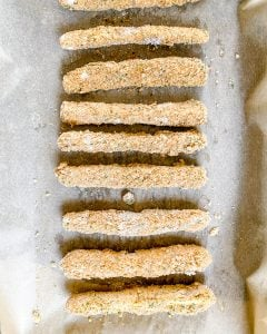 several zucchini fries on parchment paper