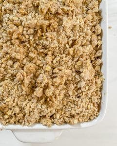 plum crisp in white container with a white background