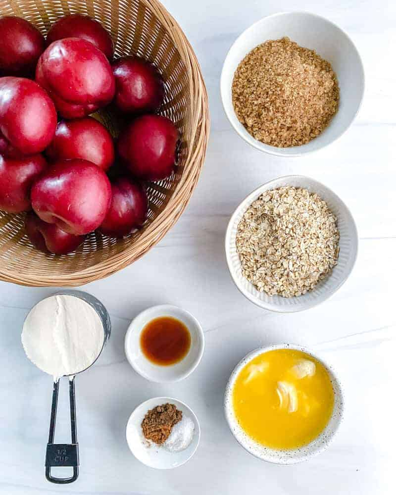 crisp plums ingredients in a white background