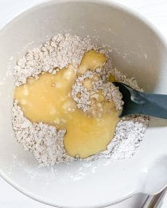 plum crisp ingredients in white bowl in white background