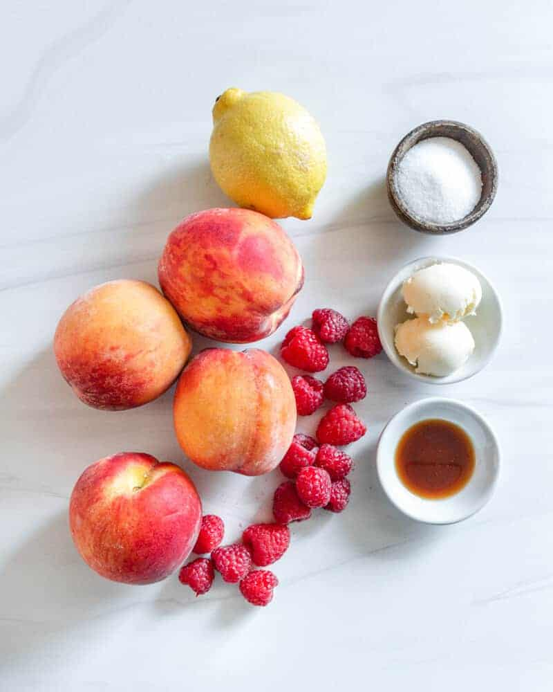 Roasted peaches Ingredients with a white marble background