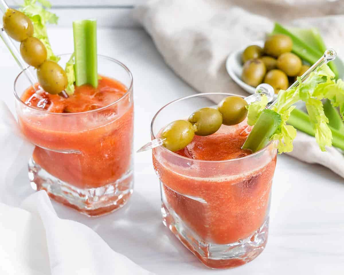 two glasses of vegan virgin bloody mary against white background