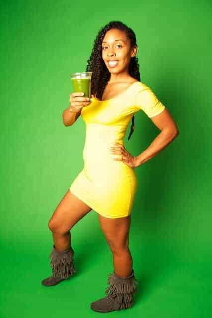 Authoer Afya Ibomu holding a green smoothie.