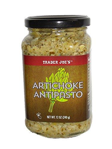 artichoke antipasto in glass jar against white background