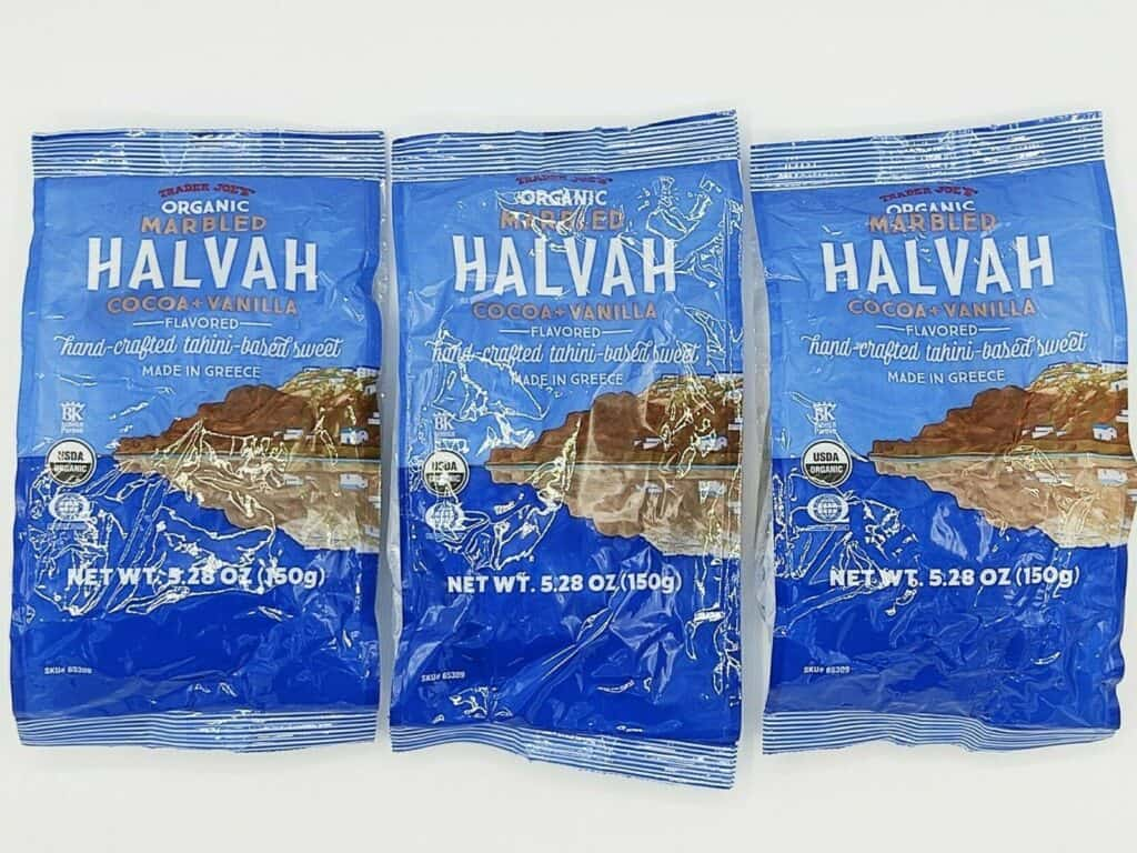 3 packages of marbled halvah against a white background
