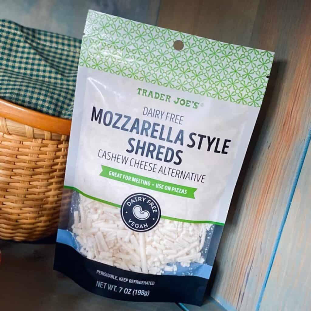 mozarella shreds packaging against dark background