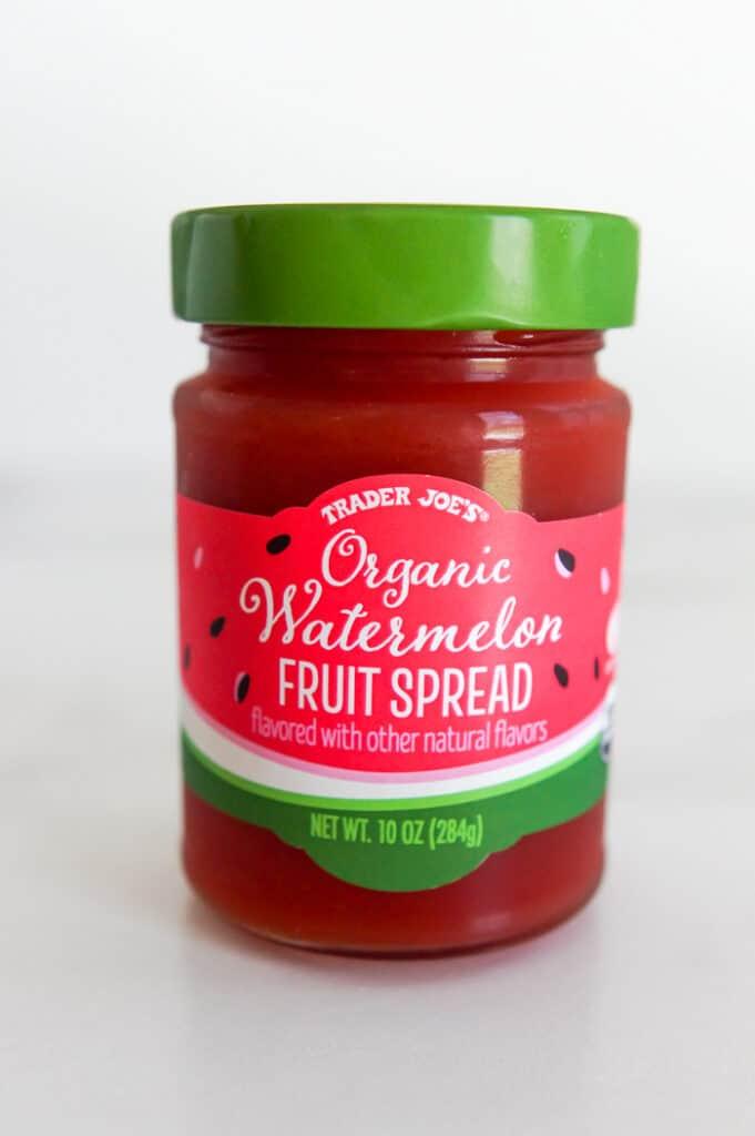 organic watermelon fruit spread in jar against white background