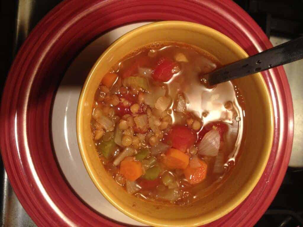 Bowl full of veggie lentil soup.