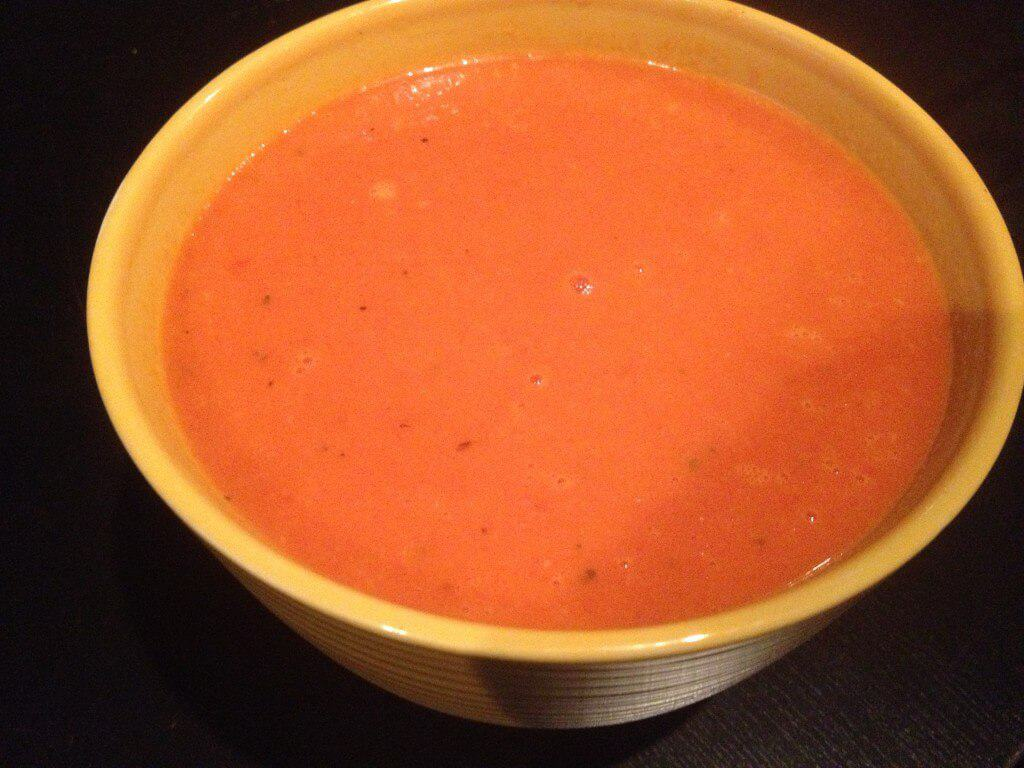 Dairy free creamy tomato soup in a bowl.
