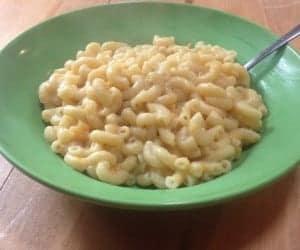 "Bowl filled with vegan sweet potato macaroni and ""cheese."""
