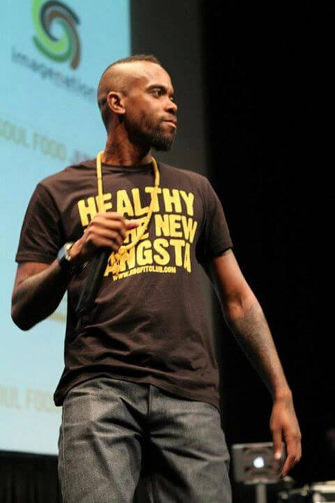 """Stic wearing a """"Healthy is the New Gangsta: t-shirt."""