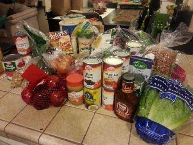 A week's worth of groceries set out on the kitchen counter.