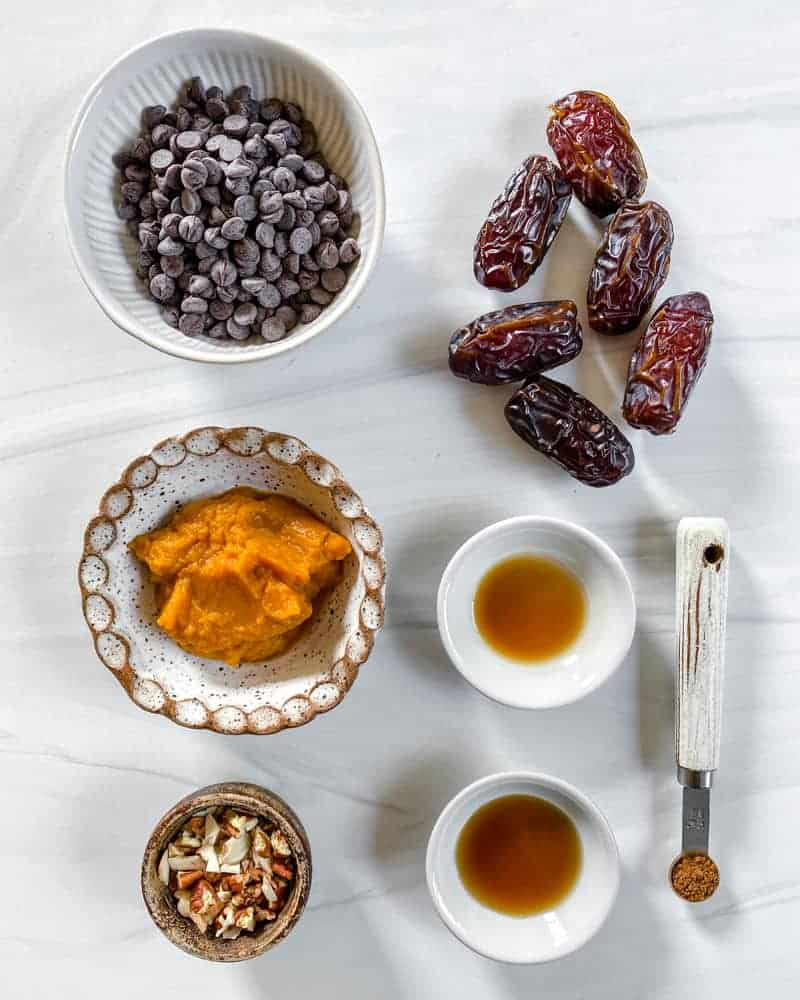 Pumpkin Stuffed Dates Ingredients displayed on white marble surface